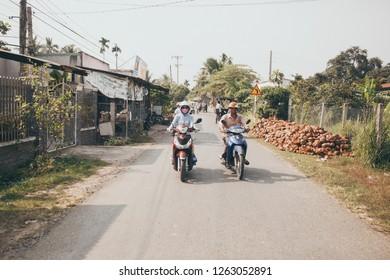 Saigon/Vietnam - 01.05. 2018 vietnamese people driving motobikes. Vietnam