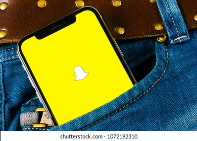 Saikt-Petersburg, Russia, April 14, 2018: Snapchat application icon on Apple iPhone X smartphone screen close-up in jeans pocket. Snapchat app icon. Social media icon. Social network