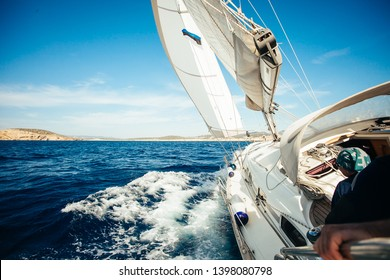 Sail boat in action on the sea