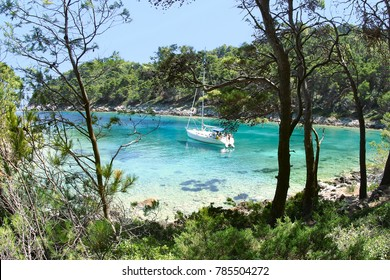 sail boat anchoring in romantic lagoon, Mljet island, Croatia
