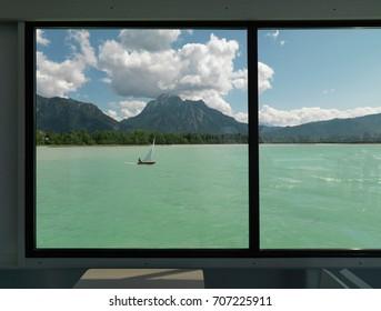 Sail boat crossing lake