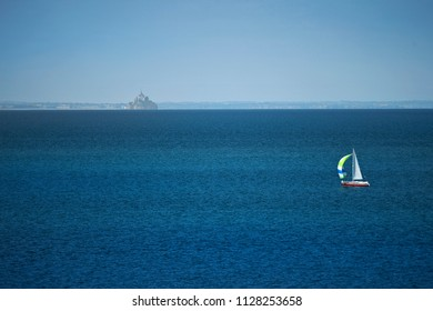 Sail boat facing Mont Saint Michel in France