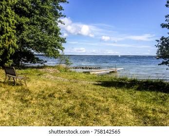 Sail boat at the horizon