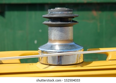 Sail boat mast reel used to reel in the sails on a sail boat