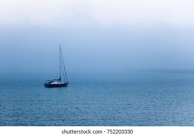 Sail boat in the morning fog