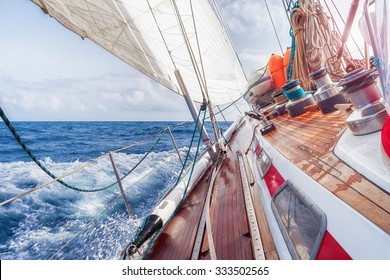 sail boat navigating on the waves