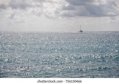 Sail boat on a horizon