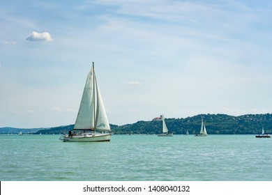 sail boat on the lake view of Tihany from Balatonfüred