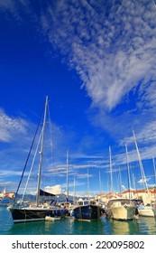 Sail boats anchored on a pier near the Adriatic sea, Trogir, Croatia