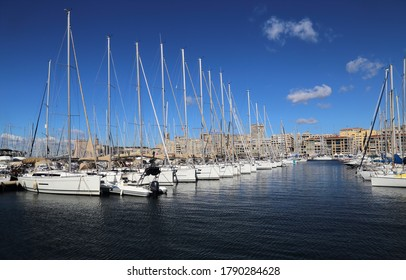 Sail boats and buildings in the old harbor of Marseille, France