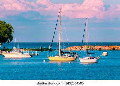 Sail boats docked at the marina at Mackinac Island during sunset
