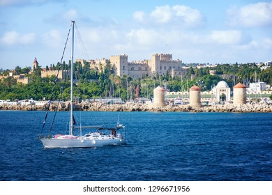 Sail boats in front of Grand Master palace in City of Rhodes (Rhodes, Greece)