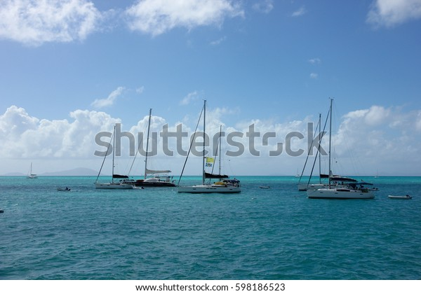 sail boats moored off the coast of Anegada, British Virgin Islands