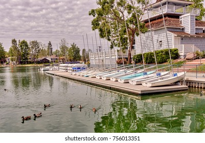 Sail boats on docks and ducks swimming in Westlake Village lake in Southern California
