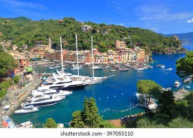 Sail and motor boats inside the harbor of Portofino, Italy