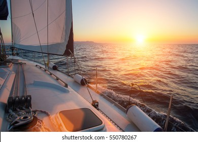 Sail yachts in the Sea. Luxury boat during sunset.