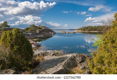 sailboat at anchor in a lonly bay of Gubbor Kupa Skerry island in the Stockholm skerry garden, swedish eastcoast