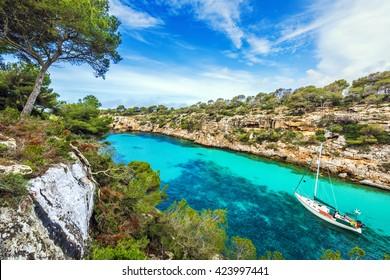 Sailboat anchored at the idyllic cove of Cala Pi, Majorca, Spain, Europe