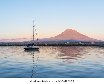 Sailboat anchored inside Horta harbor, in Faial island of Azores, Portugal.