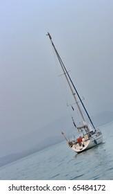 Sailboat anchored near land