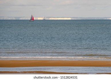sailboat between the French coasts and the English cliffs