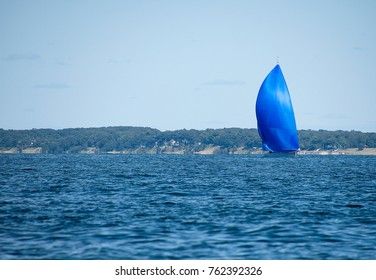 sailboat with blue spinnaker sailing on Lake Michigan
