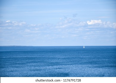 Sailboat in calm blue water by the swedish island Oland in the Baltic Sea
