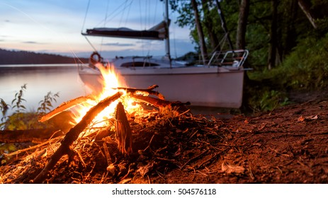 Sailboat and campfire in eastern Poland
