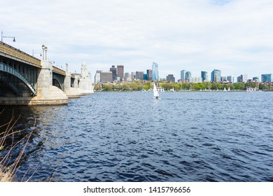 Sailboat in the Charles River with the Boston skyline and city in the background