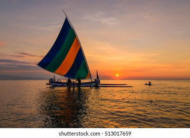 Sailboat and colorful sunset