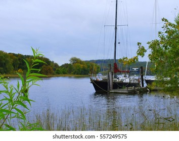Sailboat docked in the beautiful Connecticut river valley area. Early autumn