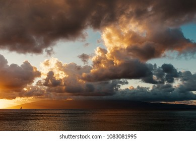 A Sailboat Enjoys A Sunset Cruise On The Pailolo Channel Between Molokai And The Island Of Maui