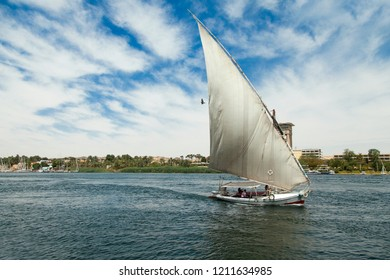 Sailboat or felucca with folded sail  in theNile River, Egypt  Aswan