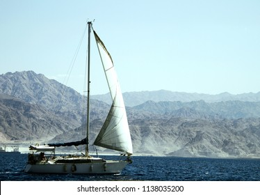 Sailboat floating on the red sea