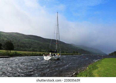 Sailboat floats channel in windy weather, Scotland