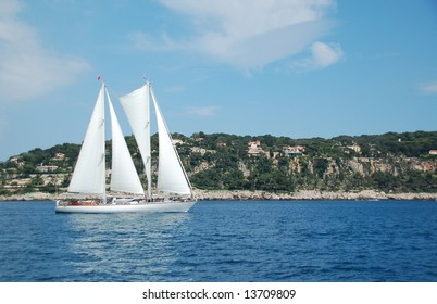 Sailboat in front of French Riviera coast