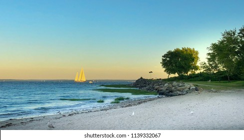 Sailboat in front of glowing sky