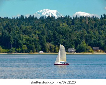 Sailboat in front of Mt. Rainier from Vashon Island in the Puget Sound near Tacoma and Seattle