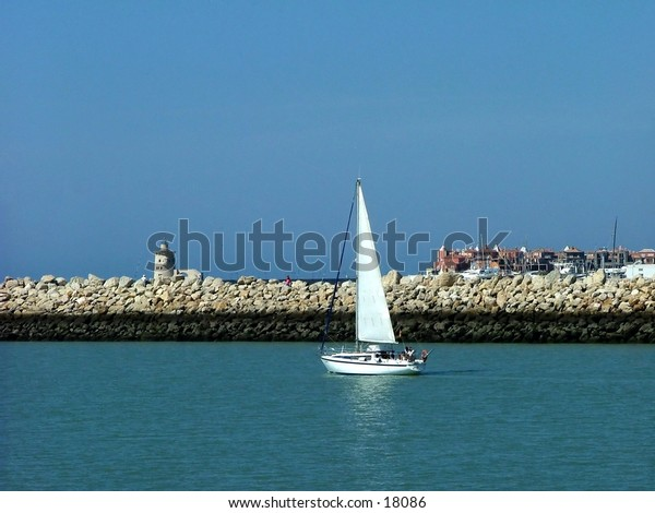 Sailboat going out of harbour