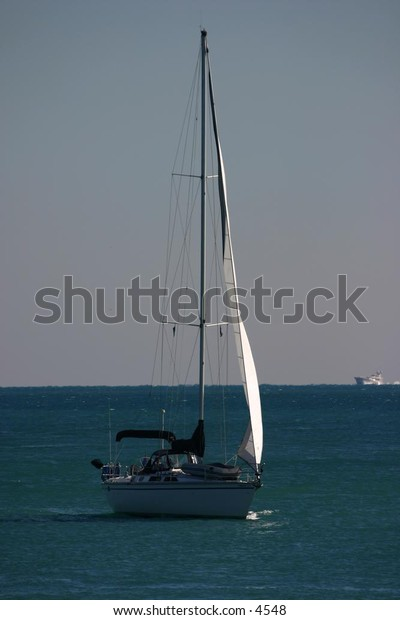 sailboat leaving the harbour