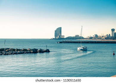 Sailboat leaving the port of Barcelona