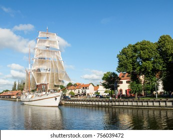 Sailboat Meridianas in the river Dane. Port of Klaipeda, Lithuania. Sunny day in Klaipeda old town.