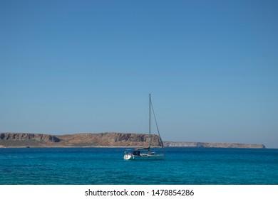 Sailboat near Balos/Crete, enjoying clyrstal clear waters