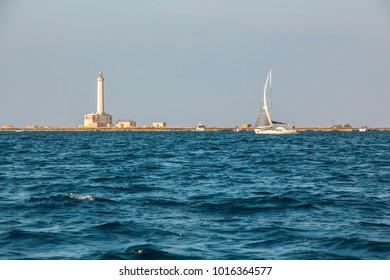Sailboat near lighthouse  (St Andrea Island), Gallipoli, Salento, South Italy