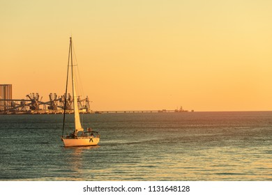 Sailboat in the ocean during sunset time Holiday lifestyle