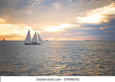 A sailboat off the coast of Key West sailing into the sunset