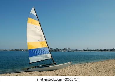 Sailboat on beach; Mission Bay; San Diego, California