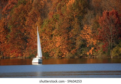Sailboat on a lake in autumn