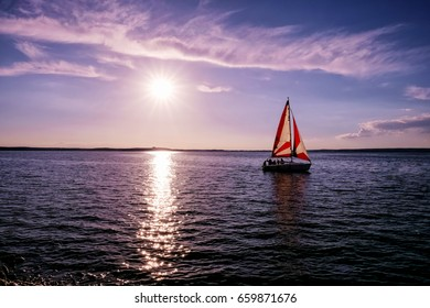 Sailboat on the lake, landscape sunset