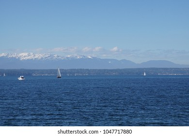 Sailboat on Puget Sound with Olympic mountains in background, Seattle, Washington